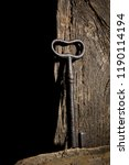 vintage key hanging on an old... | Shutterstock . vector #1190114194