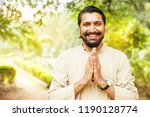handsome indian man showing... | Shutterstock . vector #1190128774