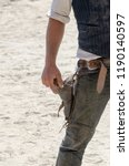 cowboy about to take his gun... | Shutterstock . vector #1190140597