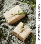 gift boxes on a warm knitted... | Shutterstock . vector #1190212597