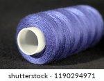 bobbin of blue threads on dark... | Shutterstock . vector #1190294971