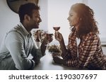 afro american couple drinking... | Shutterstock . vector #1190307697