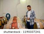 handsome man winemaker in a... | Shutterstock . vector #1190337241