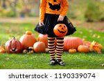 children in black and orange... | Shutterstock . vector #1190339074