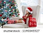 child drinking hot chocolate at ... | Shutterstock . vector #1190345527