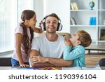 the happy father in headphones... | Shutterstock . vector #1190396104