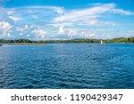 sailing at the lake | Shutterstock . vector #1190429347