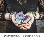 healer woman holding different... | Shutterstock . vector #1190467771