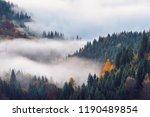 foggy sunrise over the mountain ... | Shutterstock . vector #1190489854