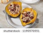 fresh baked acorn squash... | Shutterstock . vector #1190570551