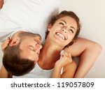 young lovely couple lying on... | Shutterstock . vector #119057809