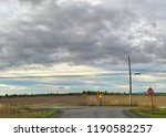 crossroad in the middle of a... | Shutterstock . vector #1190582257
