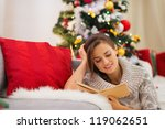 Woman Reading Book Near...