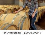 woman winemaker checks oak wine ...   Shutterstock . vector #1190669347