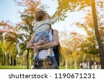 young modern happy mom with... | Shutterstock . vector #1190671231