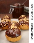 eclairs with chocolate and nuts ... | Shutterstock . vector #1190810521