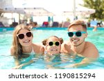 happy family in pool on sunny... | Shutterstock . vector #1190815294