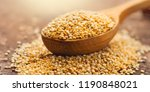 Stock photo quinoa white grains in a wooden spoon gluten free healthy food diet dieting concept seeds of 1190848021