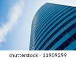 massive business building rises ... | Shutterstock . vector #11909299