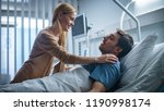 in the hospital  happy wife... | Shutterstock . vector #1190998174