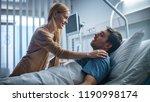 in the hospital  happy wife... | Shutterstock . vector #1190998174