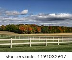 white fence around pasture with ... | Shutterstock . vector #1191032647