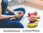 a woman holding a plate of...   Shutterstock . vector #1191079924