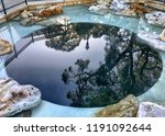 natural spring in green cove... | Shutterstock . vector #1191092644