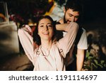 cheerful woman with man behind... | Shutterstock . vector #1191114697