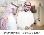 saudi business  hands signing a ... | Shutterstock . vector #1191181264