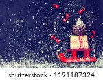 red christmas sleigh carrying...   Shutterstock . vector #1191187324