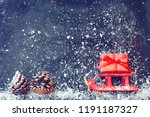 red christmas sleigh carrying...   Shutterstock . vector #1191187327
