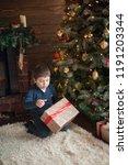 beautiful baby boy on christmas ...   Shutterstock . vector #1191203344
