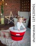 beautiful baby on christmas...   Shutterstock . vector #1191203401