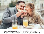 beautiful loving couple sitting ... | Shutterstock . vector #1191203677