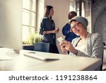 cheerful businesswoman on break ... | Shutterstock . vector #1191238864