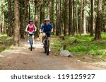 girls riding bikes | Shutterstock . vector #119125927