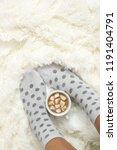 woman feet in polka dot socks...   Shutterstock . vector #1191404791