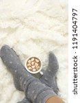 woman feet in warm woolen socks ... | Shutterstock . vector #1191404797