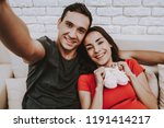 selfie. husband and pregnant... | Shutterstock . vector #1191414217