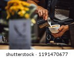 barista making coffee in coffee ... | Shutterstock . vector #1191470677