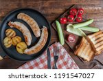 grilled sausages on frying pan  ... | Shutterstock . vector #1191547027