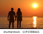 young couple holding hands... | Shutterstock . vector #1191588661