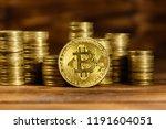 golden bitcoin and stacks of... | Shutterstock . vector #1191604051
