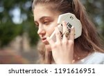 young girl with a phone | Shutterstock . vector #1191616951
