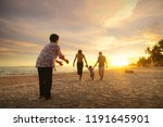 grandmother and her family play ... | Shutterstock . vector #1191645901