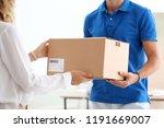 young woman receiving parcel... | Shutterstock . vector #1191669007