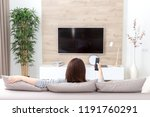 young woman watching tv in the... | Shutterstock . vector #1191760291