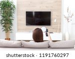 young woman watching tv in the... | Shutterstock . vector #1191760297