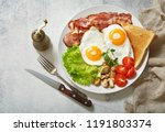 breakfast with plate of fried... | Shutterstock . vector #1191803374
